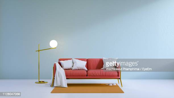 sofa in modern living room at home - electric lamp stock pictures, royalty-free photos & images
