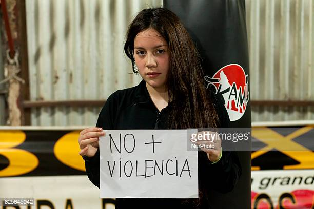Sofía Jimenez fifteen years old amateur boxer from the School of Carlos quotLátigoquot Uribe holds in her hands a sign saying quotNo to violencequot...