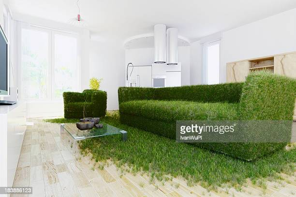 A sofa made of grass in a modern room showing green living