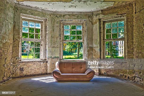 Sofa On Floor In Abandoned House