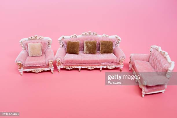 sofa on pink background