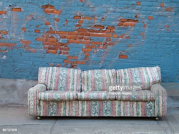 sofa on sidewalk - beaten up stock pictures, royalty-free photos & images