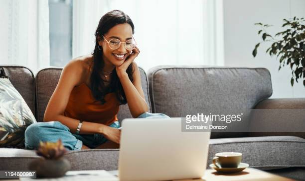 sofa time is for movie marathons - content stock pictures, royalty-free photos & images