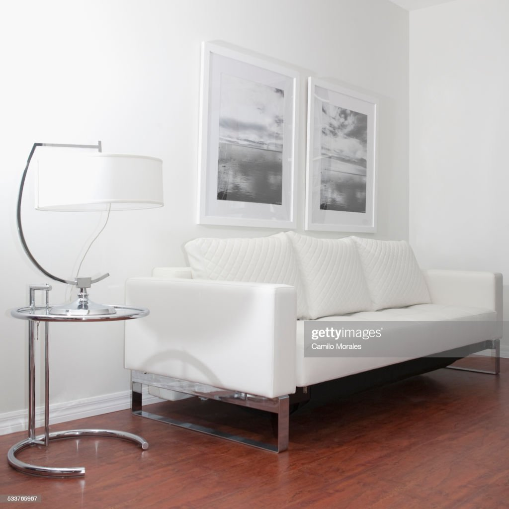Sofa Wall Art And Lamp In Modern Living Room Stock Photo