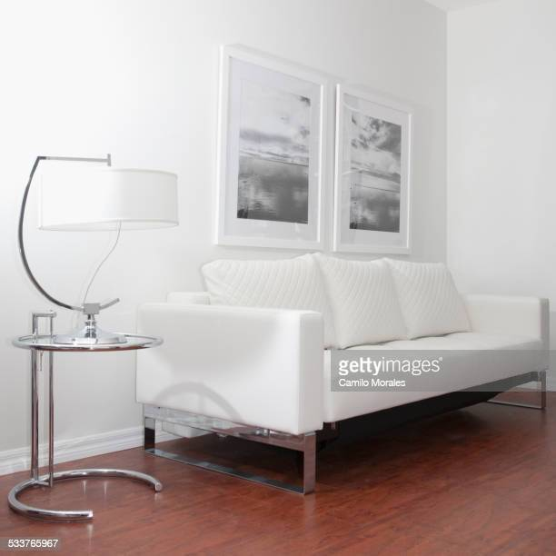 Sofa, wall art and lamp in modern living room