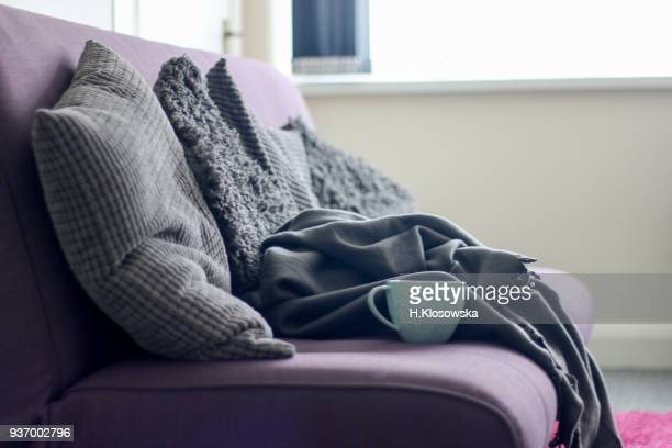 sofa with cushions and blankets - cushion stock photos and pictures