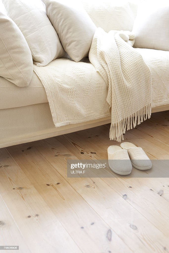Sofa with matching slippers in living room : Stock Photo