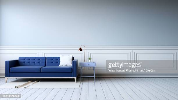 sofa with table by wall at home - home interior stock pictures, royalty-free photos & images