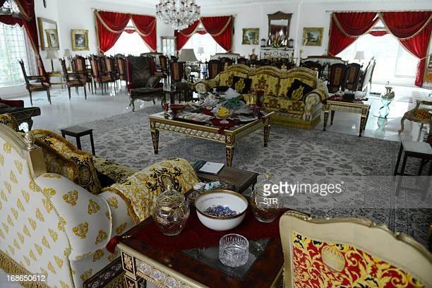 Sofas and other furniture adorn a room inside Pakistan's incoming prime minister Nawaz Sharif's farm house in Raiwind in the outskirts of Lahore on...