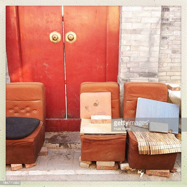 Sofas are put in front of the gate of a house in the alley in downtown of Beijing, China. The photo was taken on April 11, 2013.