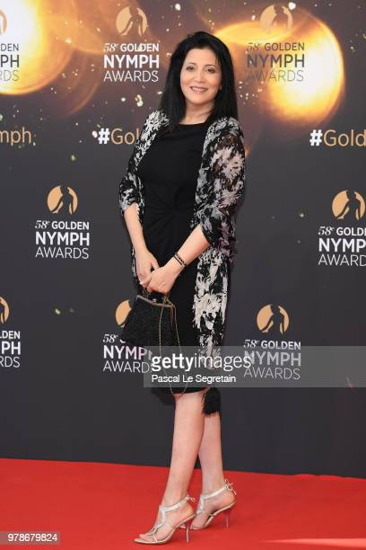 Isabelle Degeorges and a guest attend the closing ceremony and Golden Nymph awards of the 58th Monte Carlo TV Festival on June 19 2018 in MonteCarlo...