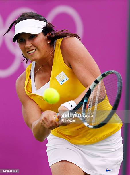 Sofia Arvidsson of Sweden plays against Vera Zvonareva of Russia during her Women's Singles Tennis match on Day 1 of the London 2012 Olympic Games at...