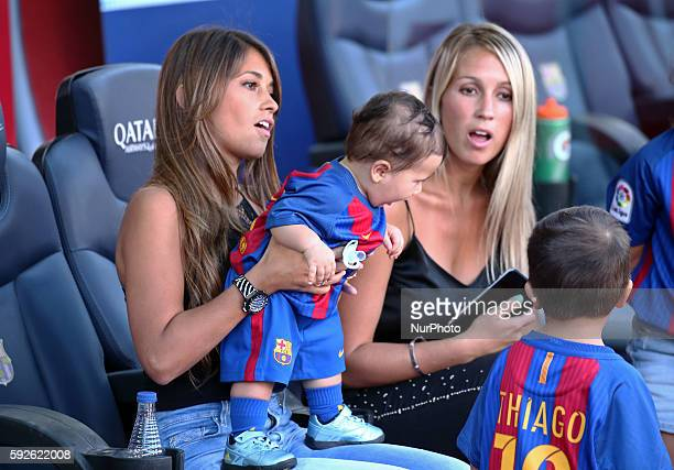 Sofia Balbi the wife of Luis Suarez and Antonella Roccuzzothe wife of Leo Messi with his children Thiago and Mateo during La Liga match between FC...