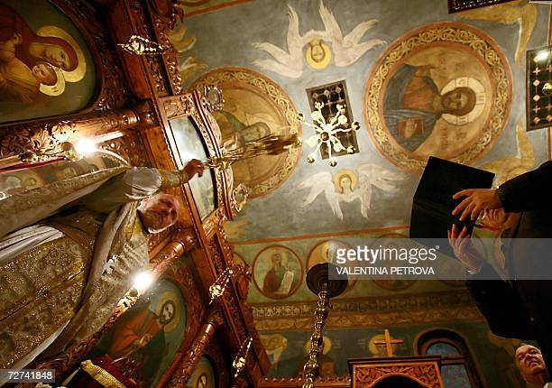 An Orthodox priest attends a service in the church of St Nicholas during the Day of Saint Nicholas celebrations in Sofia 06 December 2006 AFP PHOTO /...
