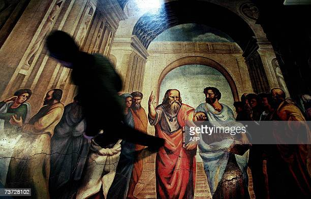 Picture taken 23 March 2007 shows a Bulgarian student passes along a copy of the fresco originally named School of Athens and originally painted in...
