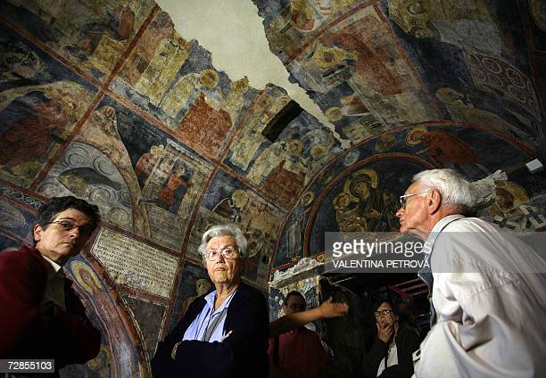 Picture taken 06 July 2006 shows a tourists look at icon paintings in Boyana Church, dated back to early 11th century and undergoing restoration and...