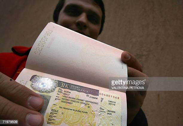 TO GO WITH AFP STORY 'Romania Bulgaria play down EU fears of new flood of workers' A Bulgarian shows his UK visa in front of the British embassy in...