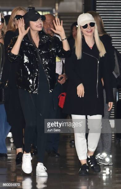 Sofia Carson and Dove Cameron are seen upon arrival at Narita International Airport on October 11 2017 in Narita Japan