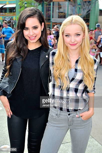 Sofia Carson and Dove Cameron of Disney's 'Descendants' perform and join fans at Downtown Disney at Disneyland Resort on October 17 2015 in Anaheim...