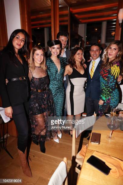 Sofia Carson Michel Heredia Frida Torresblanco Gabriel RiveraBarraza and Sylvia Banderas pose with guests at the HOLA USA VIP Dinner Celebration for...
