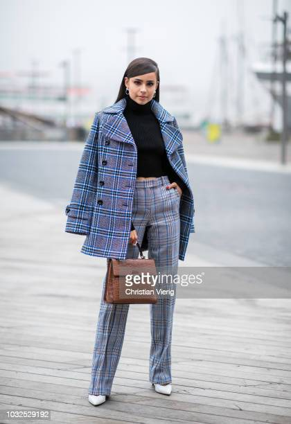 Sofia Carson wearing checked wool coat pants seen outside Michael Kors during New York Fashion Week Spring/Summer 2019 on September 12 2018 in New...