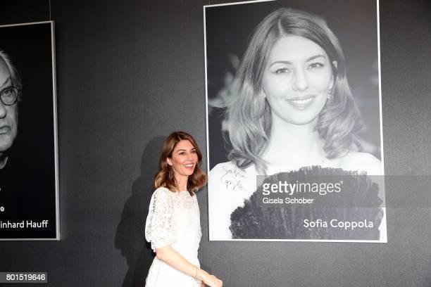 Sofia Coppola signs her photo during the premiere of the movie 'Die Verfuehrten' during the film festival Munich at Gasteig on June 26 2017 in Munich...