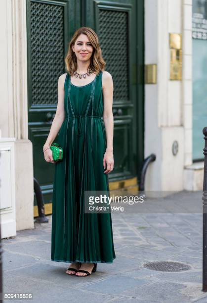 Sofia Coppola wearing a green dress and bag outside Valentino during Paris Fashion Week - Haute Couture Fall/Winter 2017-2018 : Day Four on July 5,...