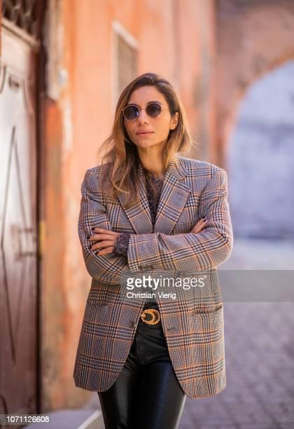 Sofia El Arabi is seen wearing checked blazer leather pants knit on November 29 2018 in Marrakech Morocco