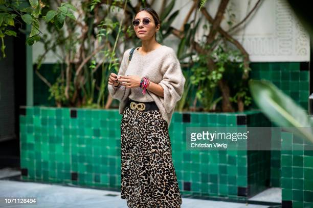 Sofia El Arabi is seen wearing midi skirt with leopard print ankle boots belt knit Chanel bag on November 29 2018 in Marrakech Morocco