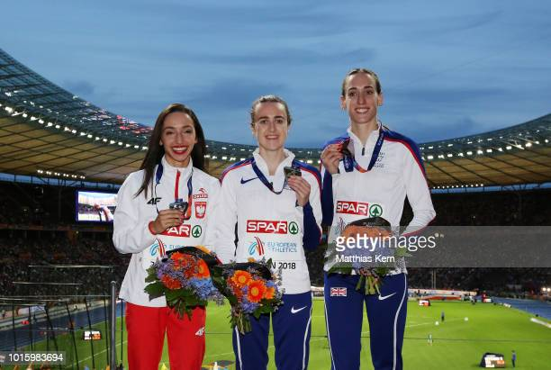 Sofia Ennaoui of Poland silver Laura Muir of Great Britain gold and Laura Weightman of Great Britain bronze pose with their medals for the Women's...