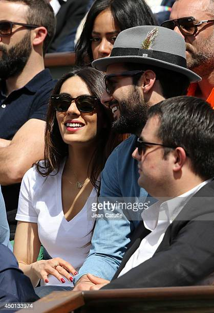 Sofia Essaidi and boyfriend Adrien Galo attend Day 12 of the French Open 2014 held at RolandGarros stadium on June 5 2014 in Paris France