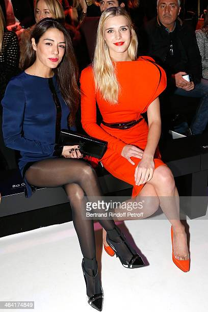 Sofia Essaidi and Gaia Weiss attend the Stephane Rolland show as part of Paris Fashion Week Haute Couture Spring/Summer 2014 on January 21 2014 in...