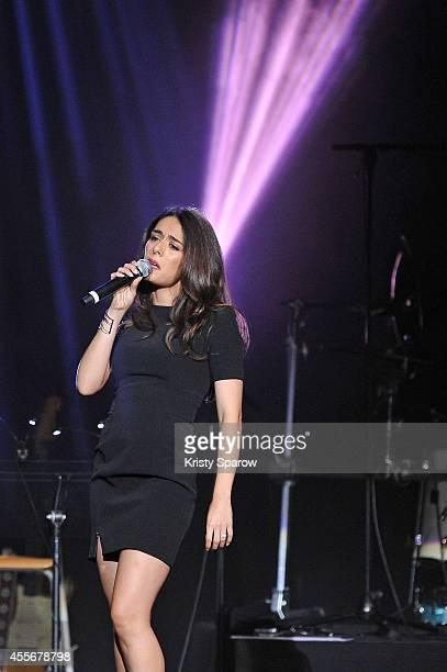 Sofia Essaidi performs onstage during 'Leurs Voix Pour L'Espoir 2014' concert at L'Olympia on September 18 2014 in Paris France
