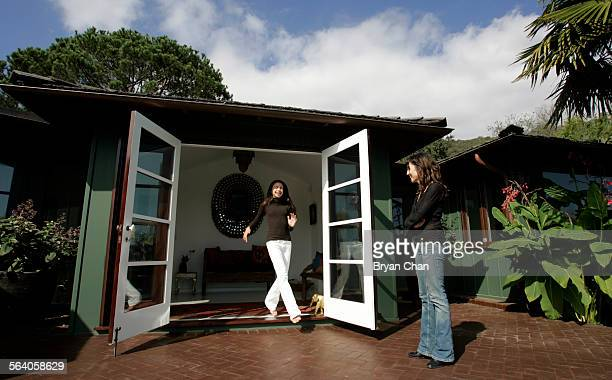 Sofia Florimbi left steps through one of several French doors to her mother Nancy Simon to the backyard deck The home has an open flow with all white...