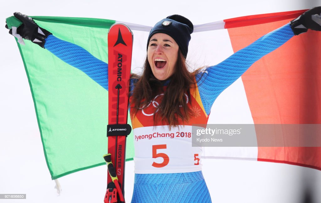 Sofia Goggia of Italy celebrates after winning the women's downhill skiing at the Pyeongchang Olympics on Feb. 21, 2018 in South Korea. ==Kyodo