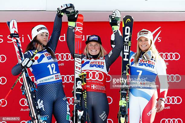 Sofia Goggia of Italy takes 2nd place Tessa Worley of France takes 1st place Lara Gut of Switzerland takes 3rd place during the Audi FIS Alpine Ski...