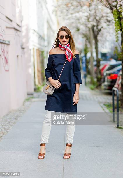 Sofia Grau is wearing white Closed jeans a navy COS dress with long sleeves a red white Chanel scarf Rayban sunglasses brown sandals with heels from...