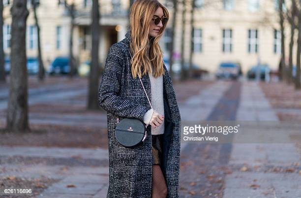 Sofia Grau Fashion Blogger and owner of SCIC Swimwear @shecomesincolors wearing a black plaid checked Urban Outfitters wool coat a white creme other...