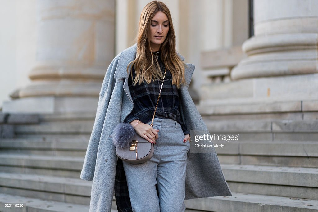 Sofia Grau (Fashion Blogger (She Comes In Colors) and owner of SCIC Swimwear, @shecomesincolors) wearing a grey Tommy Hilfiger wool coat, a black plaid Zara top, grey cropped pants COS, Chloe bag, on November 27, 2016 in Berlin, Germany.