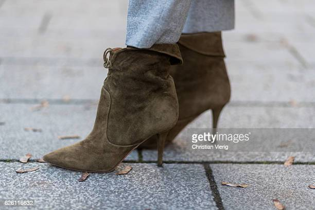 Sofia Grau Fashion Blogger and owner of SCIC Swimwear @shecomesincolors wearing khaki heeled ankle boots shoes Aquazzura on November 27 2016 in...