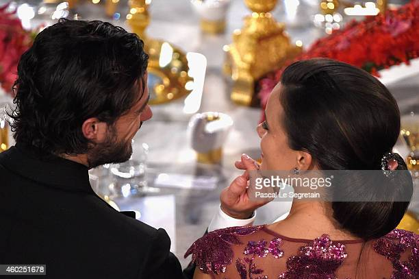 Sofia Hellqvist and Prince Carl Philip of Sweden attend the Nobel Prize Banquet 2014 at City Hall on December 10, 2014 in Stockholm, Sweden.