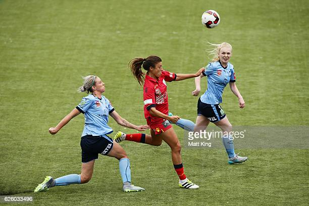 Sofia Huerta of United is challenged by Alanna Kennedy of Sydney FC and Elizabeth Ralston of Sydney FC during the round four WLeague match between...
