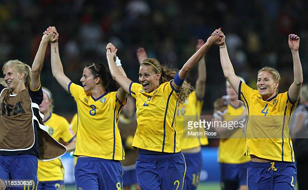 Sofia Jakobsson, Lotta Schelin, Charlotte Rohlin and Annica Svensson of Sweden celebrate after the FIFA Women's World Cup 2011 Group C match between...