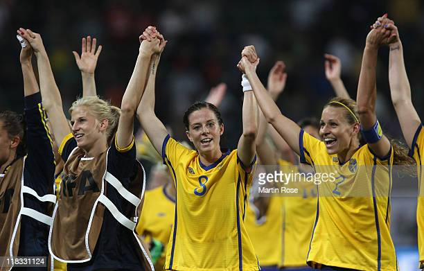 Sofia Jakobsson Lotta Schelin Charlotte Rohlin and of Sweden celebrate after the FIFA Women's World Cup 2011 Group C match between Sweden and USA at...