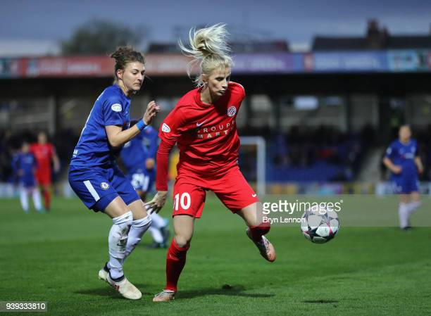 Sofia Jakobsson of Montpellier is tackled by Hannah Blundell of Chelsea during the UEFA Womens Champions League QuarterFinal second leg match between...