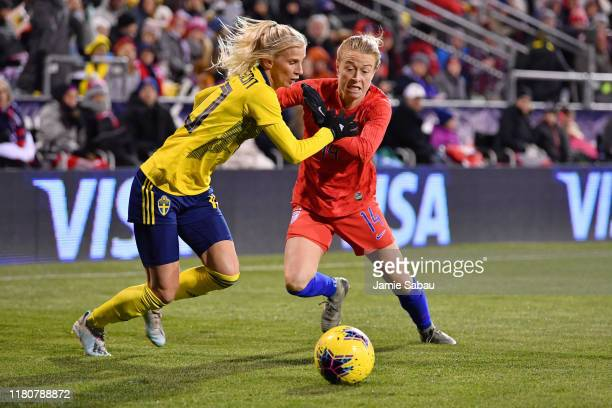 Sofia Jakobsson of Sweden and Emily Sonnett of the U.S. National Team battle for control of the ball in the second half on November 7, 2019 at MAPFRE...
