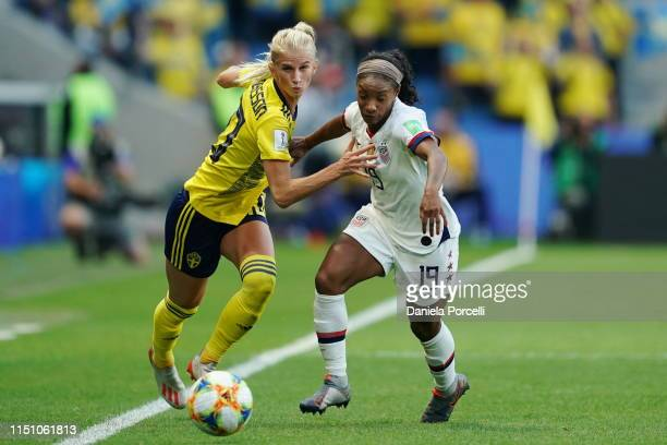 Sofia Jakobsson of Sweden attacking against Crystal Dunn of the USA during the 2019 FIFA Women's World Cup France group F match between Sweden and...