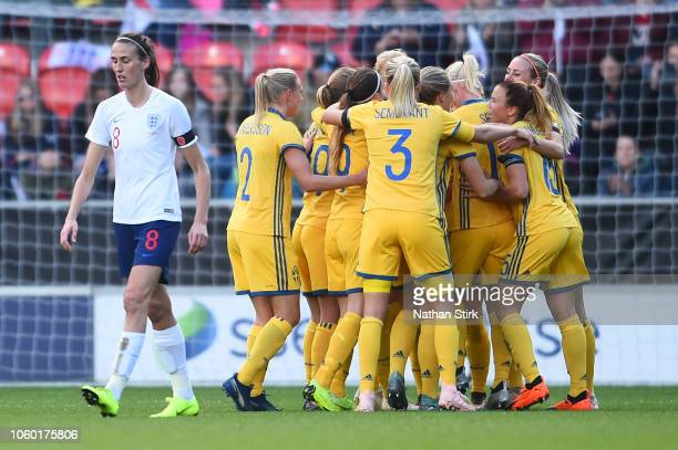 Sofia Jakobsson of Sweden celebrates with teammates after scoring her team's first goal during the International Friendly match between England Women...