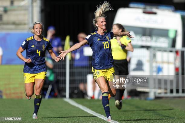 Sofia Jakobsson of Sweden celebrates with teammates after scoring her team's first goal during the 2019 FIFA Women's World Cup France Quarter Final...