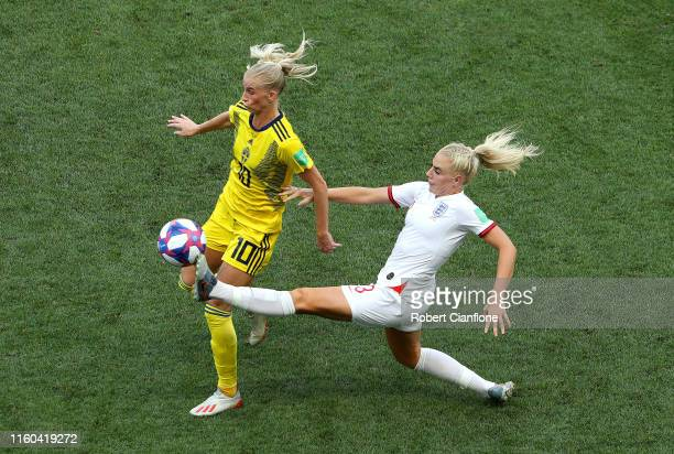 Sofia Jakobsson of Sweden is challenged by Alex Greenwood of England during the 2019 FIFA Women's World Cup France 3rd Place Match match between...